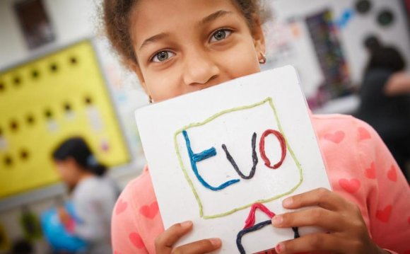 Girl with homemade TVO sign